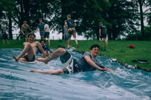 young people on slip and slide laughing for Freshers' article