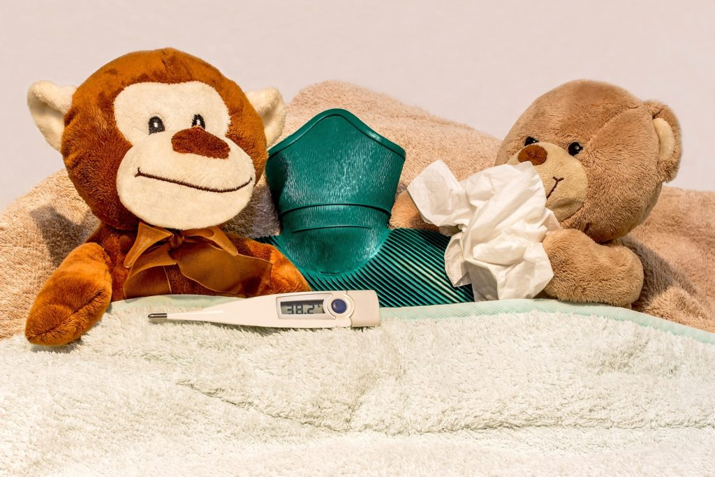 Two teddies sick in bed for How the HPV Vaccine Helps to Prevent Cancer article