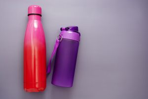 Reusable water bottles over grey background, drinking water for Reduce Single Use Plastic article