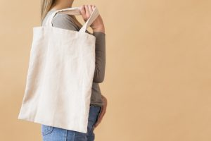 Cloth shopping bag slung over shoulder for Reduce Single Use Plastic article