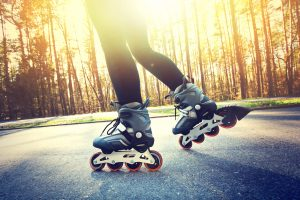 Teenage girl on roller skates at summer. For unhealthy during lockdown article