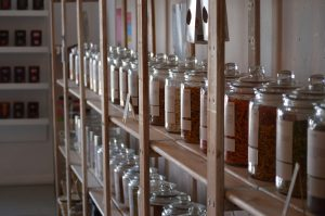 Row of jars on shelf in zero waste shop for Reduce Single Use Plastic article