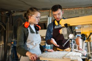 A-Level results Female apprentice being taught at drill press