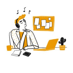 Boy at desk at home listening to music in front of laptop for Firebreak article