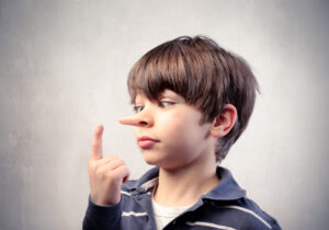 Boy with nose growing long to indicate lying for fake news blog
