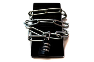 Mobile phone with chain wrapped around it with number dials to unlock for remote learning tips article