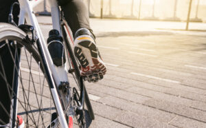 close up of foot wearing a trainer pushing down on a bike pedal for remote learning tips article