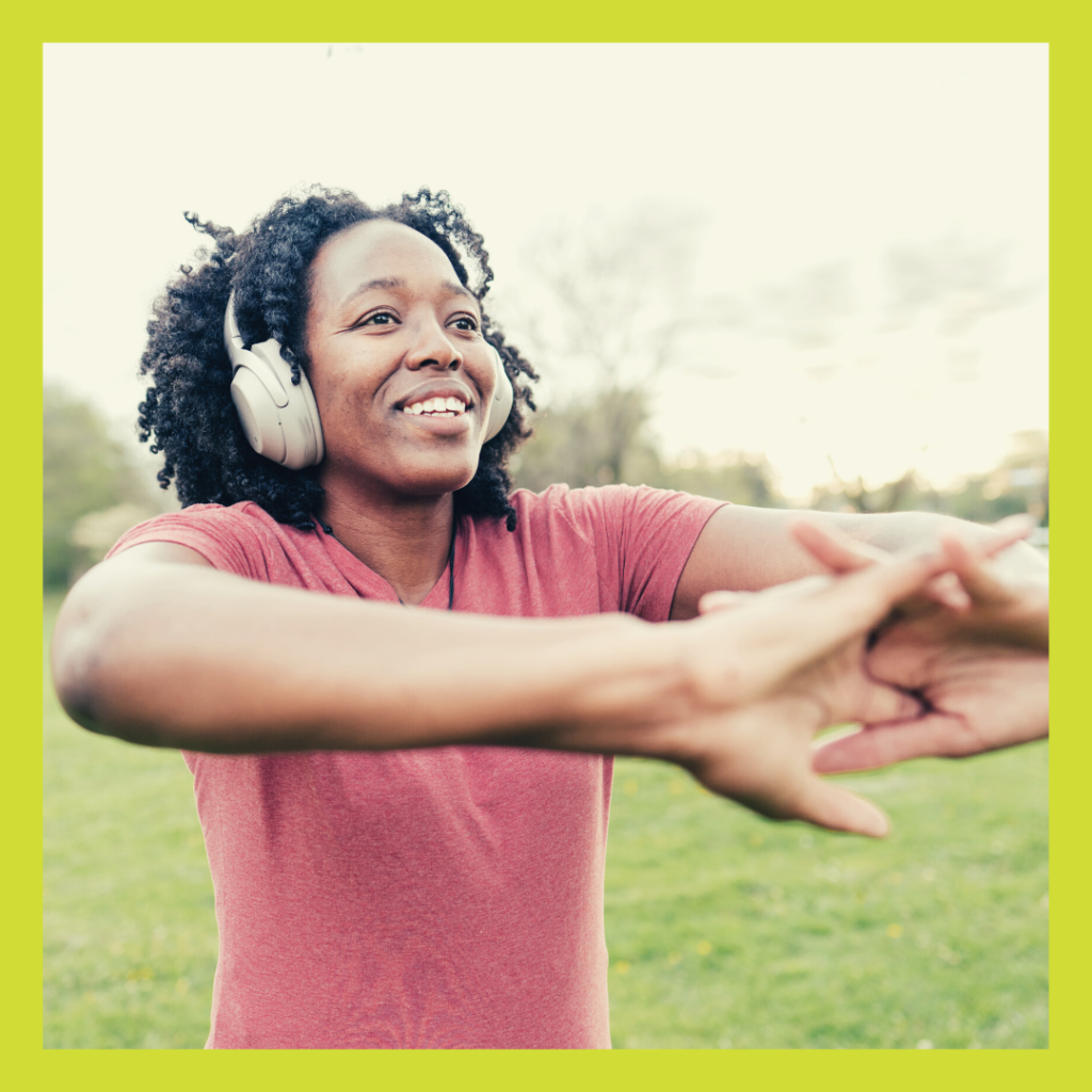 Young woman with earphones on stretching for nature and mental health blog