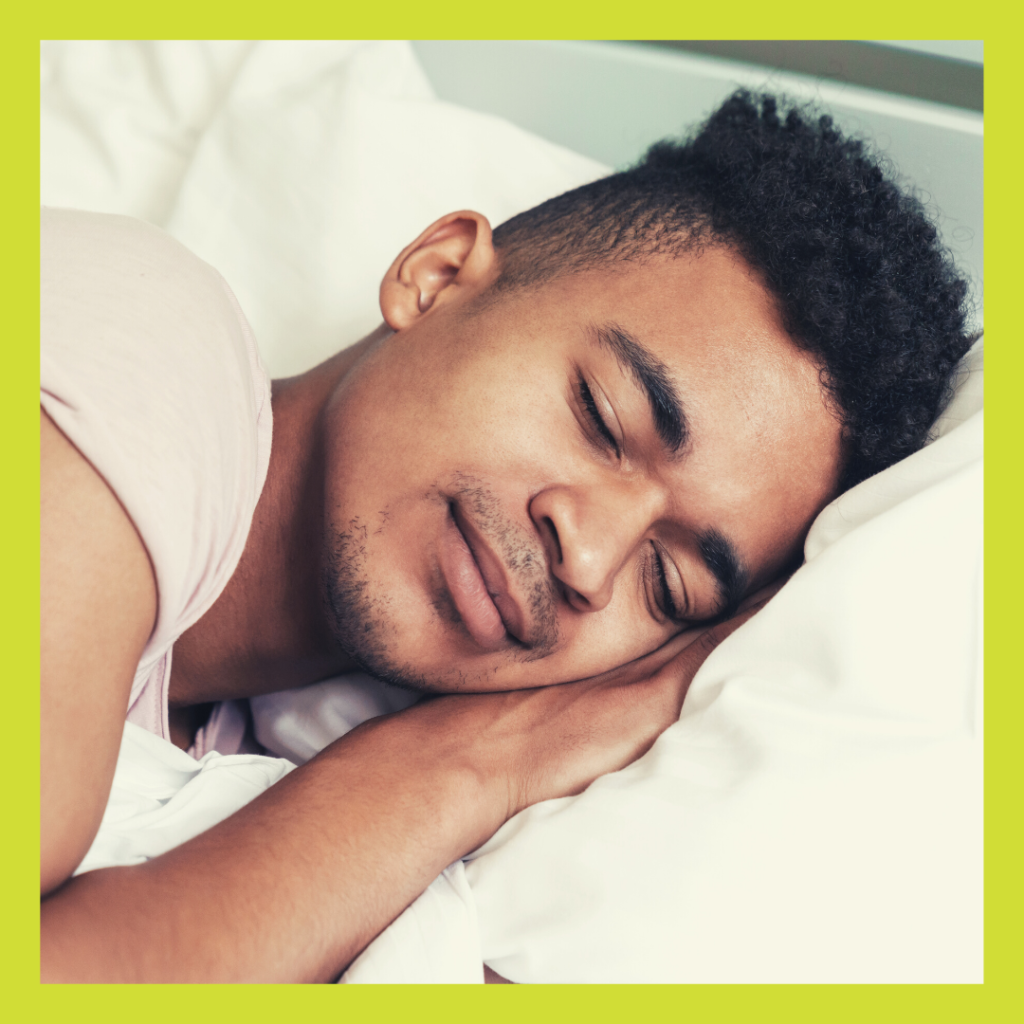 Young man with head on pillow sleeping