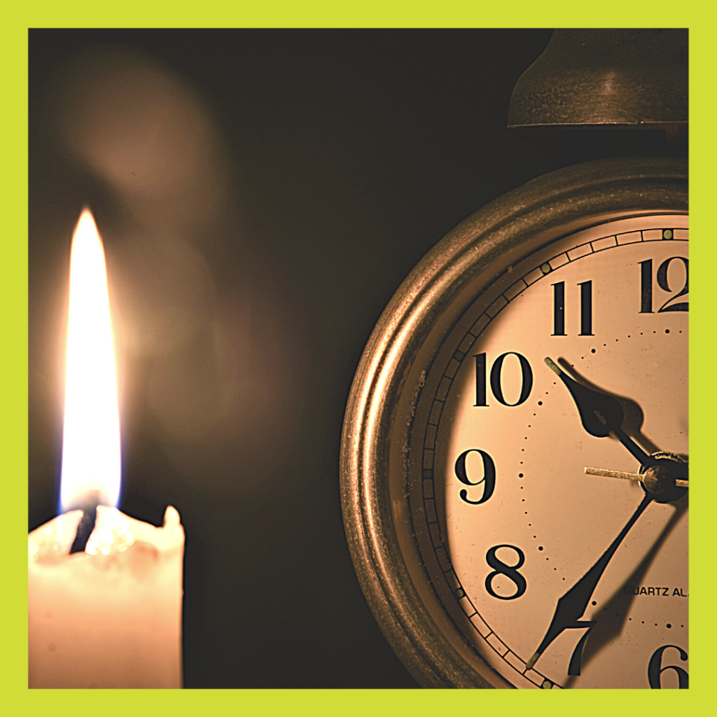 Clock and candle for 6 Steps For Better Sleep article