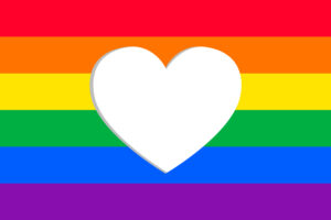 Rainbow flag with heart cut out in middle for coming out article
